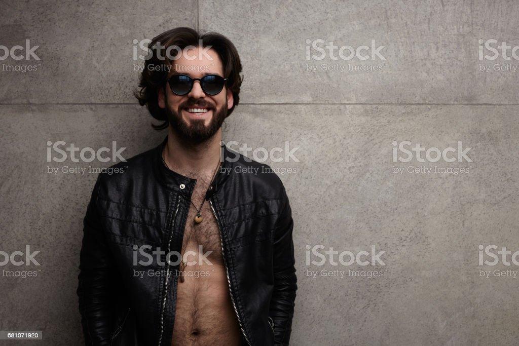 Cheerful stylish man in sunglasses royalty-free stock photo