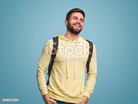 istock Cheerful successful man on blue 948531830