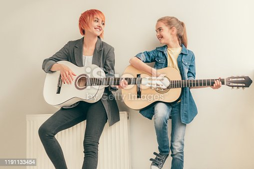 1155122702 istock photo Cheerful teacher and student during music lesson 1191133454