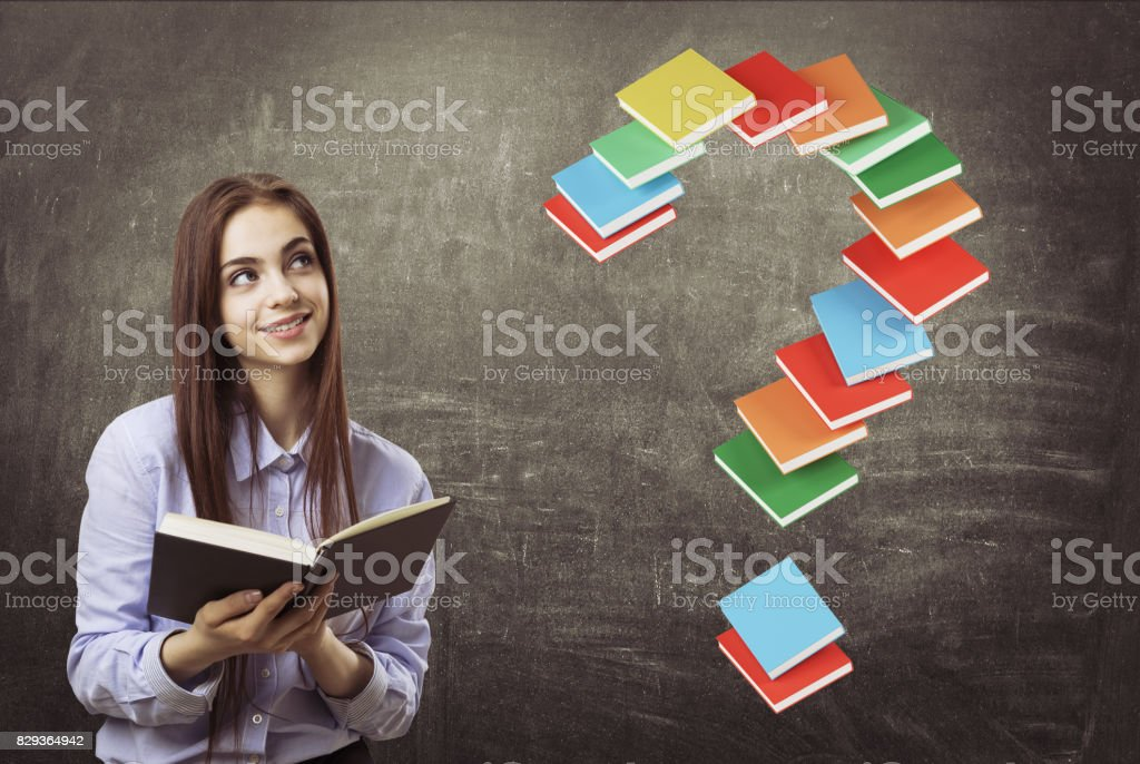 Cheerful teen girl with a book, question, books stock photo