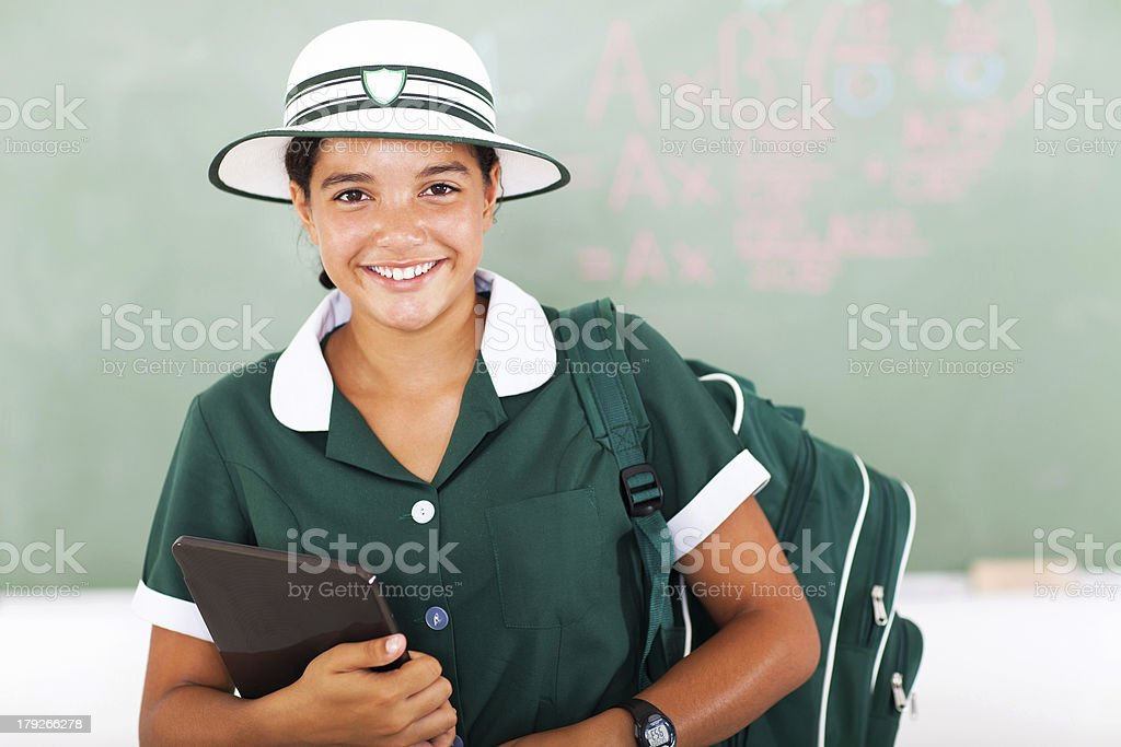 cheerful teen school girl holding tablet computer royalty-free stock photo