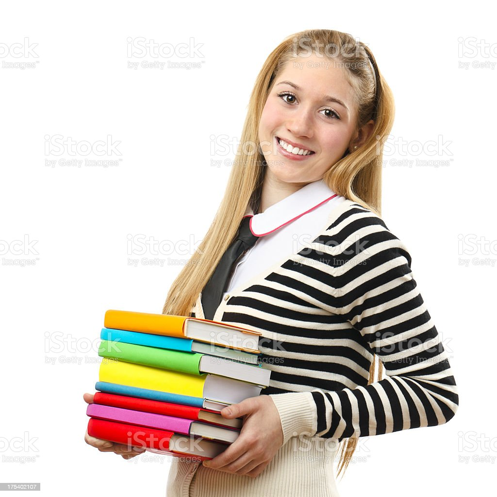 Cheerful teenage girl holding books royalty-free stock photo