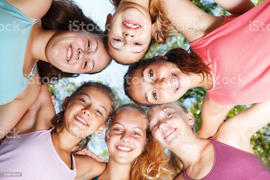 Cheerful teenage girls stock photo