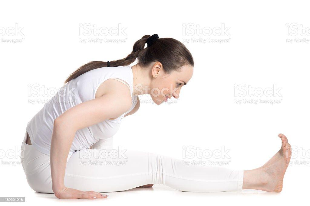 Cheerful teenager girl doing yoga practice stock photo