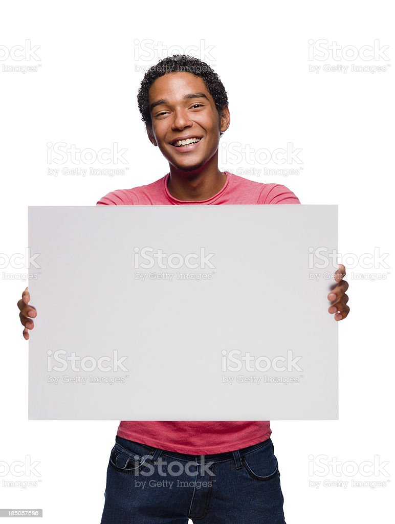 Cheerful Teenager holding a sign stock photo