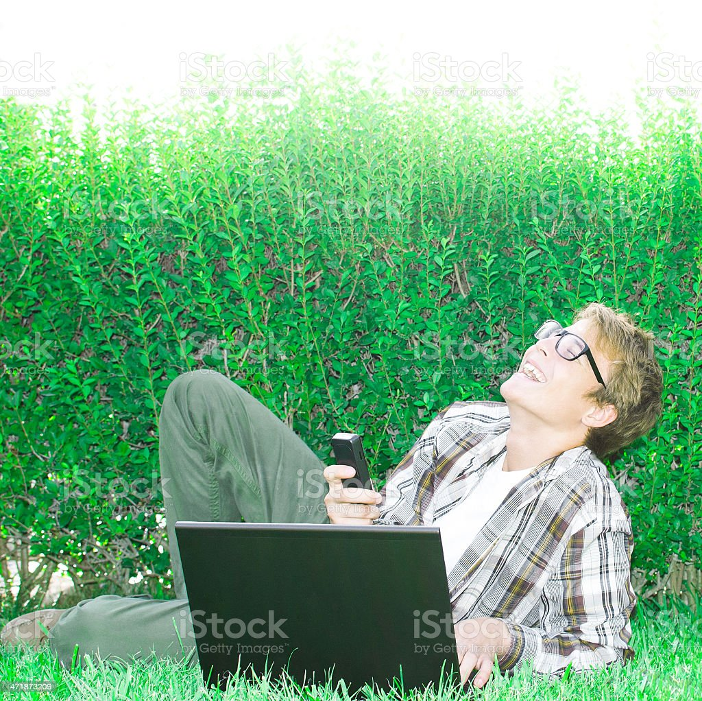 Cheerful teenager using laptop computer royalty-free stock photo