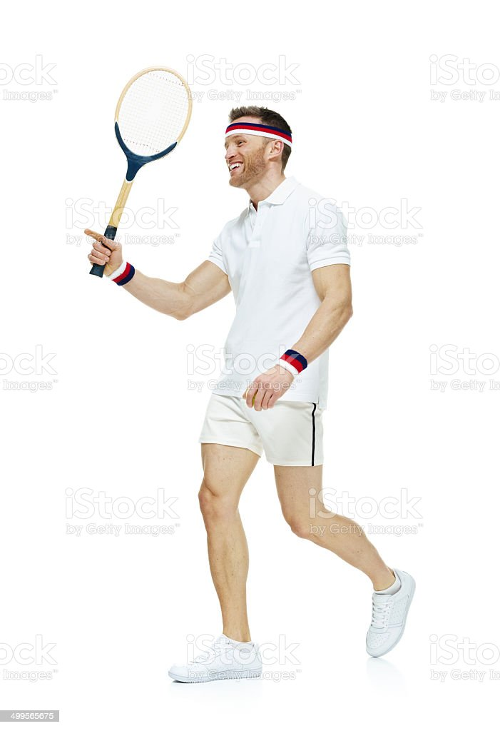 Cheerful tennis player walking royalty-free stock photo