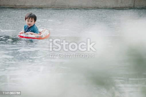 inflatable ring, boy, Asian and Indian ethnicity, fun, relaxation, hobby, swimming pool, development, child, safety, care, cute, water, looking at the camera, one person, small, fun, looking, son