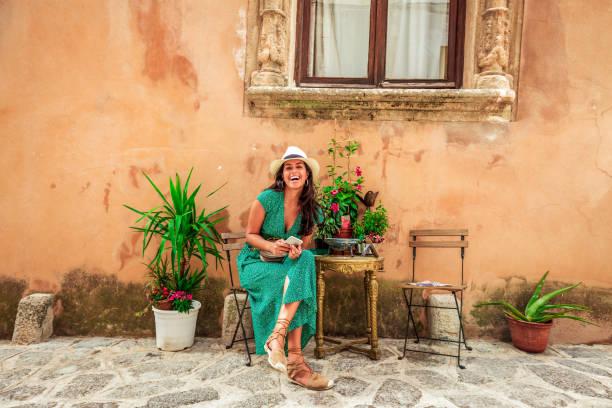 cheerful tourist woman enjoying in old town stock photo