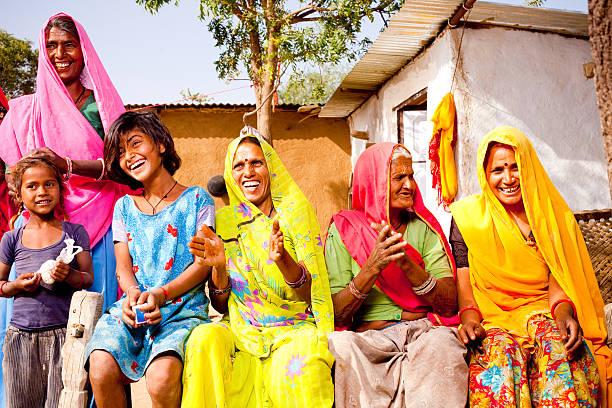 cheerful traditional rural indian family of rajasthan - köy stok fotoğraflar ve resimler