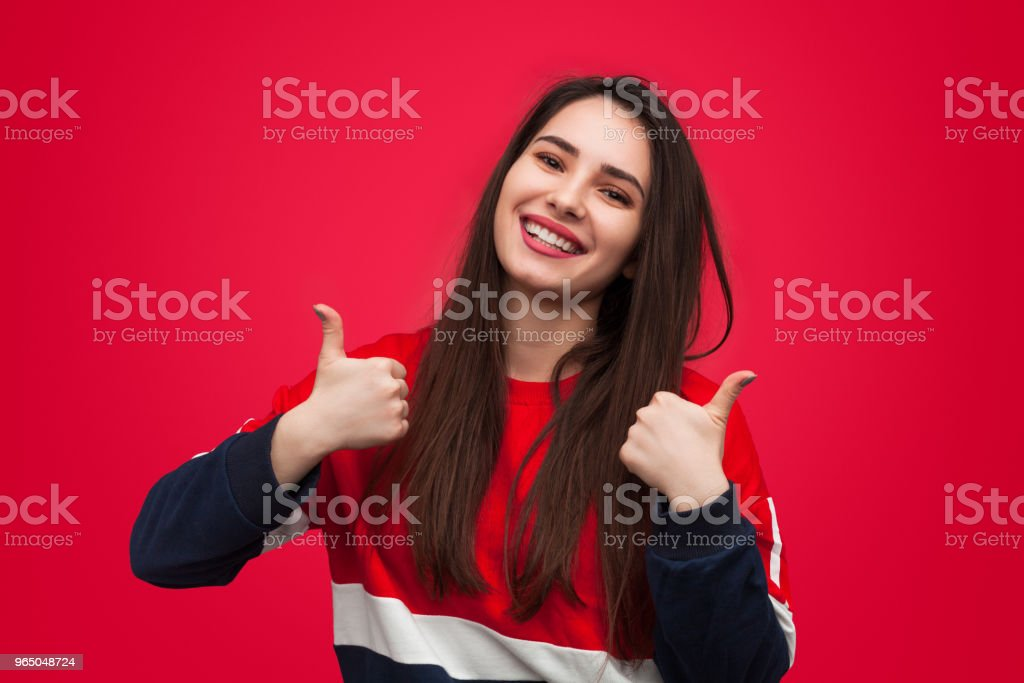Cheerful trendy girl holding thumbs up royalty-free stock photo