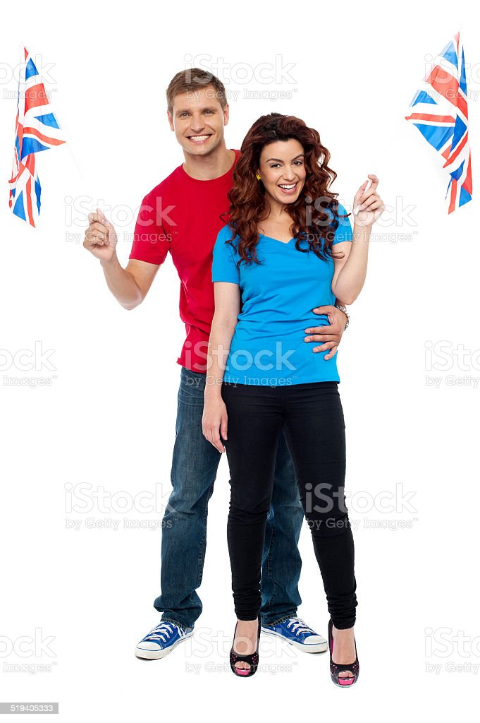 Cheerful UK supporters posing together royalty-free stock photo