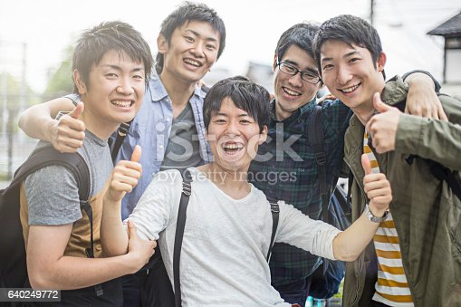 istock Cheerful university students gesturing thumbs up 640249772