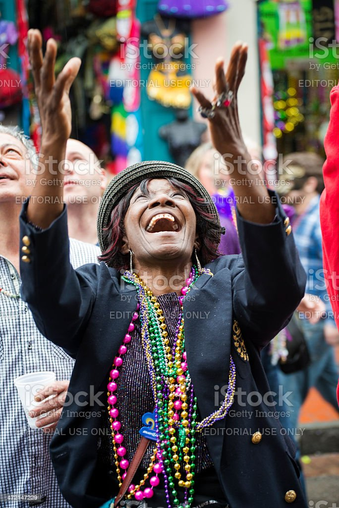 Cheerful woman at Mardi Gras 2013 in New Orleans stock photo