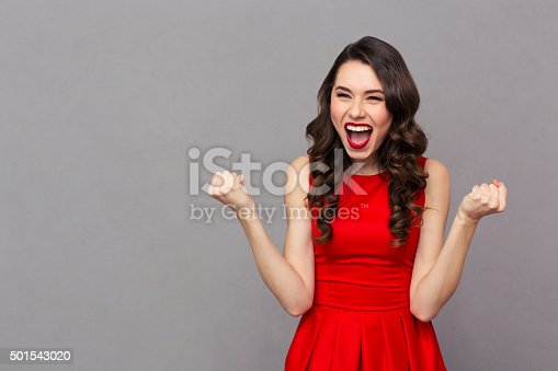 istock Cheerful woman celebrating her success 501543020