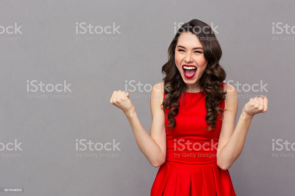 Cheerful woman celebrating her success stock photo