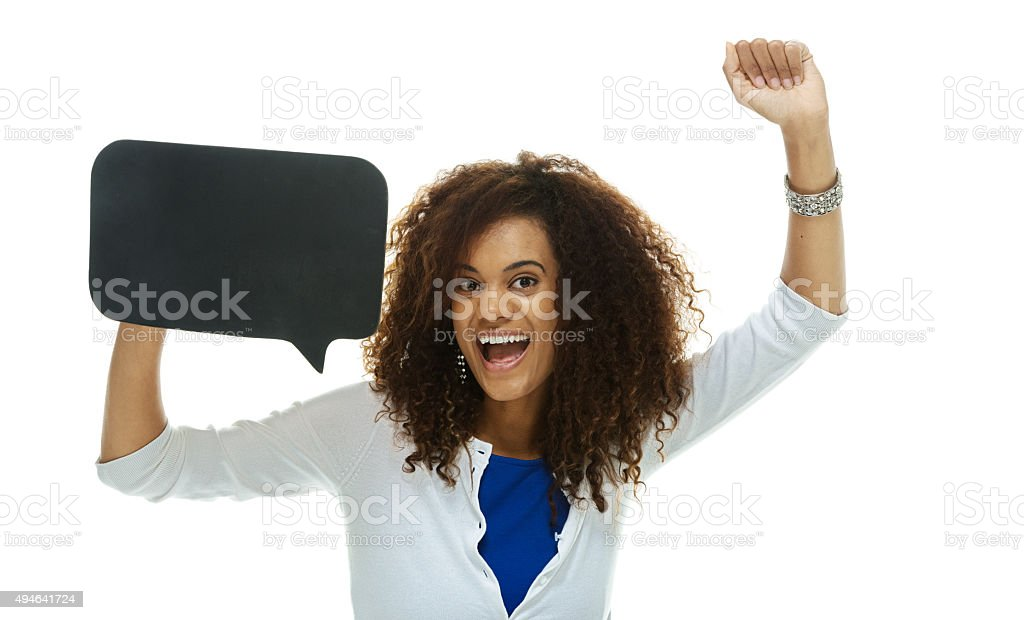 Cheerful woman cheering with speech bubble stock photo