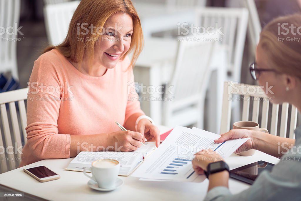 Cheerful woman conducting an interview royalty-free stock photo