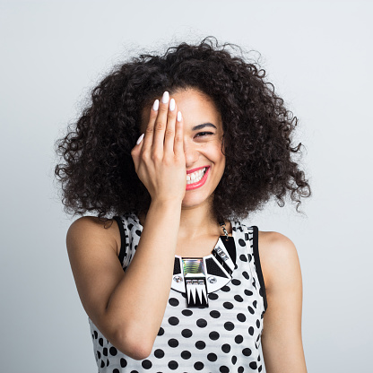 Cheerful Woman Covering Her One Eye Stock Photo - Download Image Now