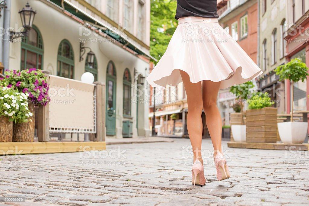Cheerful woman dancing on the street stock photo