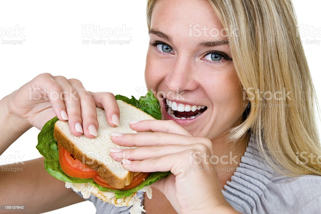 Cheerful woman eating a sandwich royalty-free stock photo