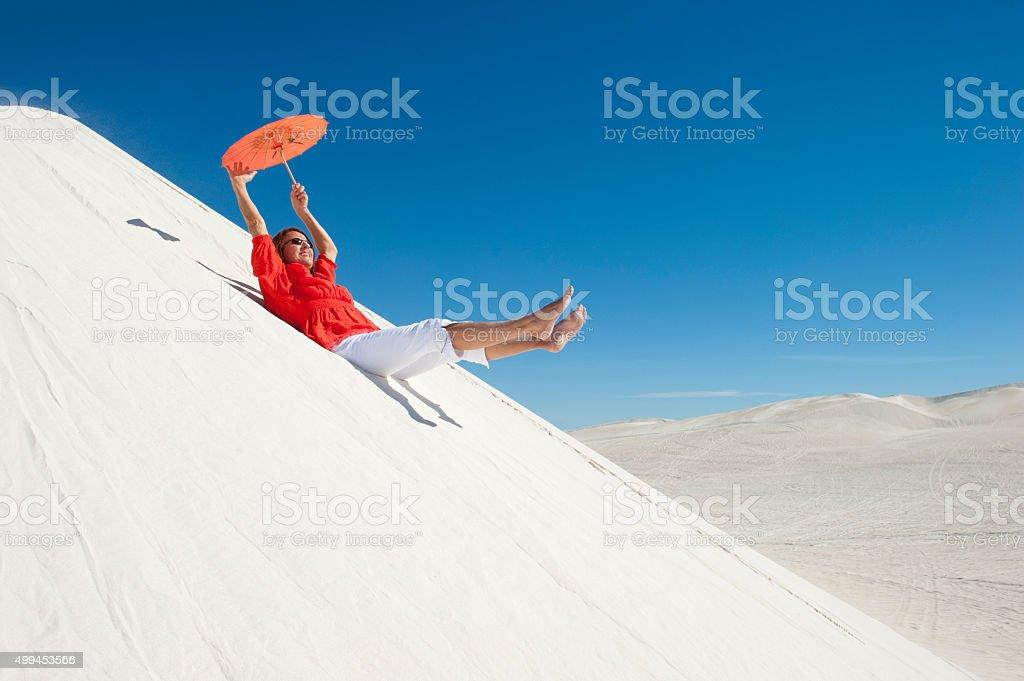 Cheerful woman enjoying outback holiday stock photo