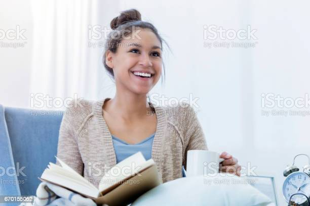 Cheerful woman enjoys relaxing at home picture id670155052?b=1&k=6&m=670155052&s=612x612&h=x b62uw7ff5bmjdhsaotvrh70fd1znx7liwlgaeweqe=