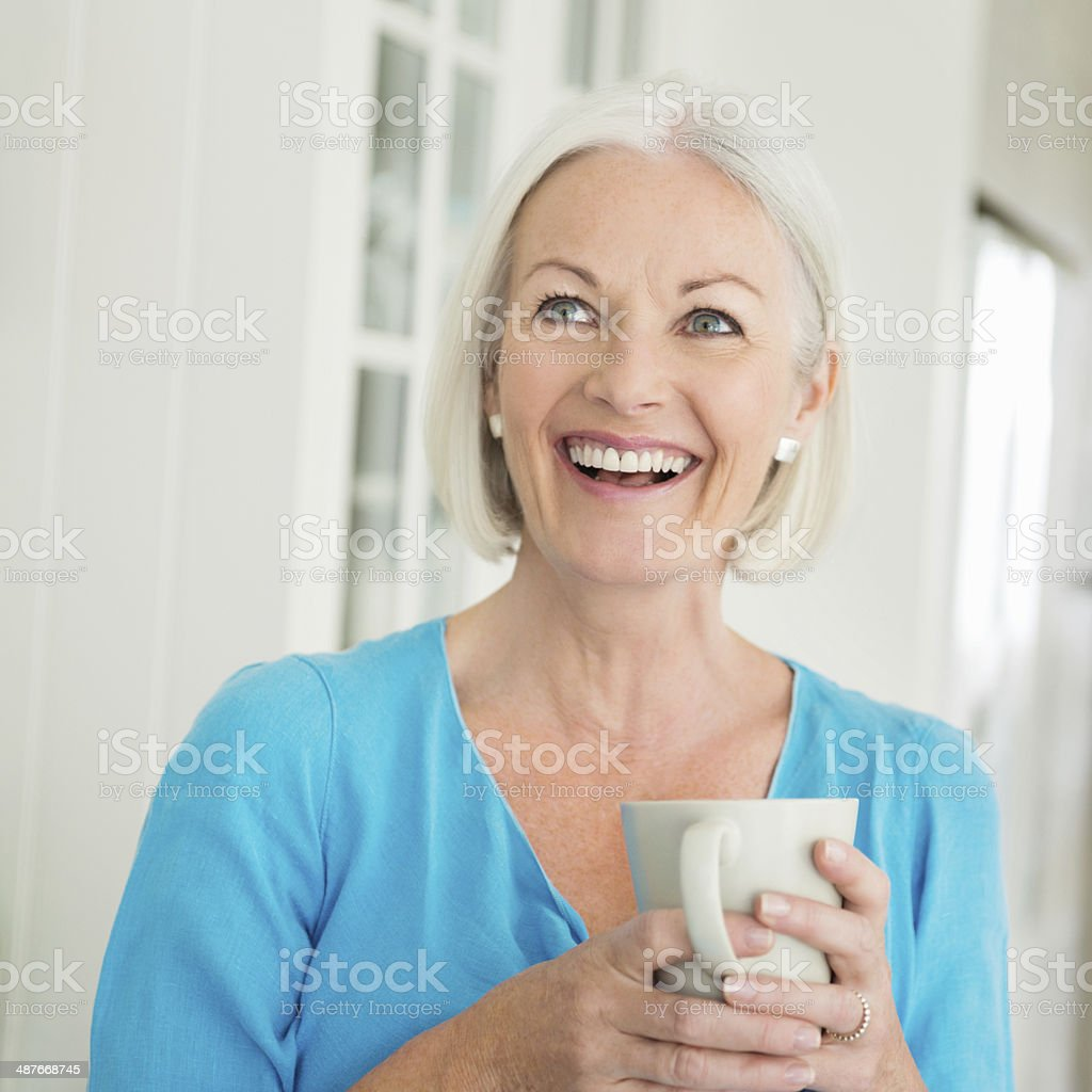 Cheerful Woman Having Coffee stock photo