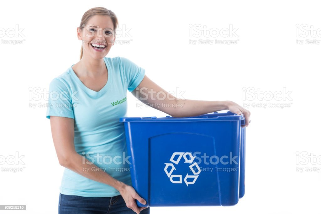 Cheerful woman helps clean up community stock photo