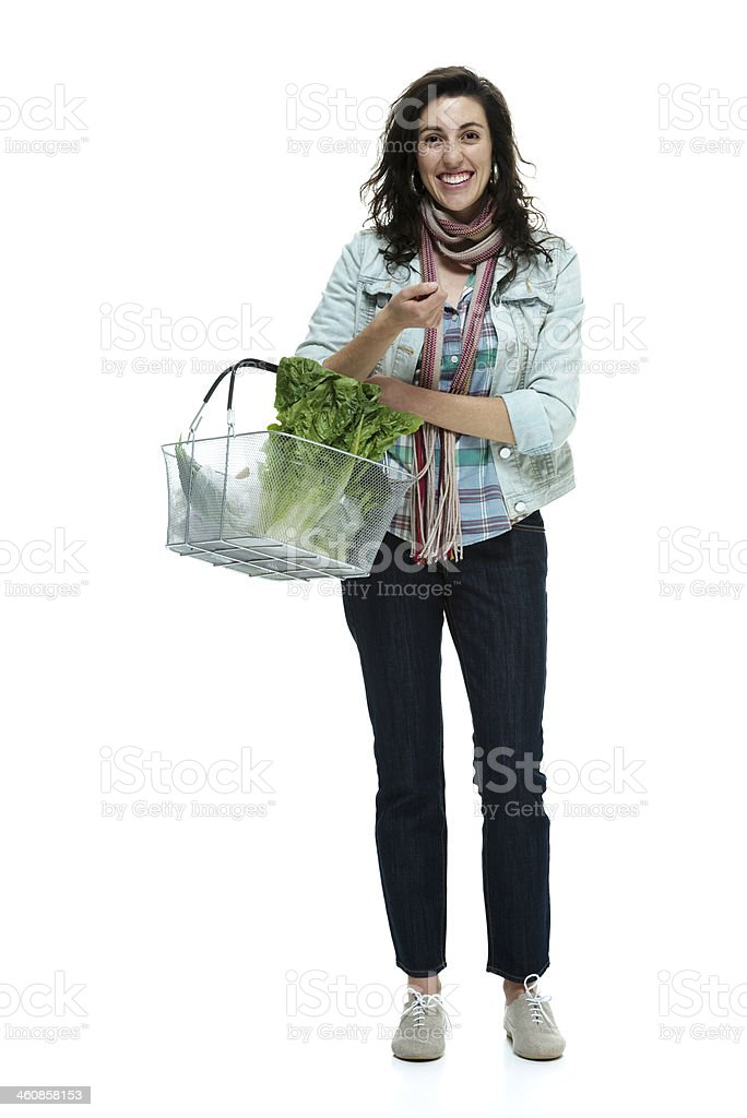 Cheerful woman holding basket royalty-free stock photo
