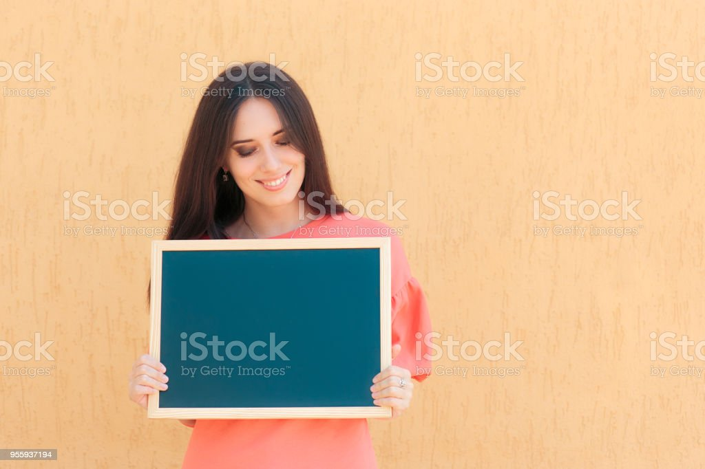 Cheerful Woman Holding Blackboard Advertising Sign stock photo