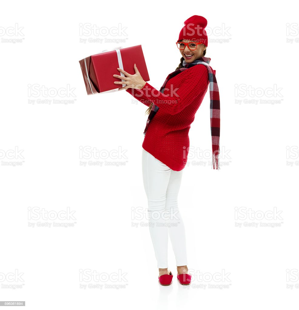 Cheerful woman holding gift box royalty-free stock photo