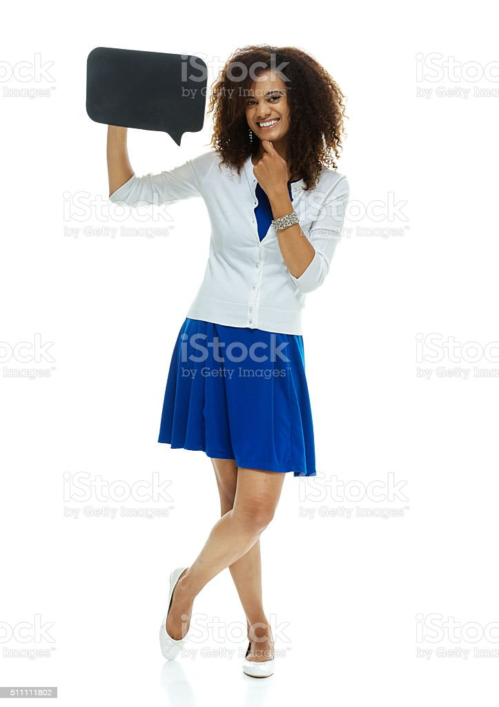 Cheerful woman holding speech bubble stock photo