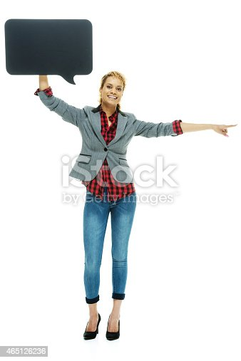 1128272390 istock photo Cheerful woman holding speech bubble pointing 465126236