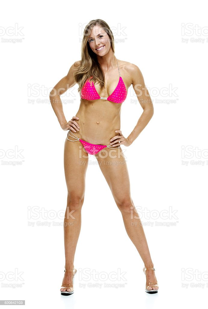 Cheerful Woman In Bikini Standing With Hands On Hips Stock