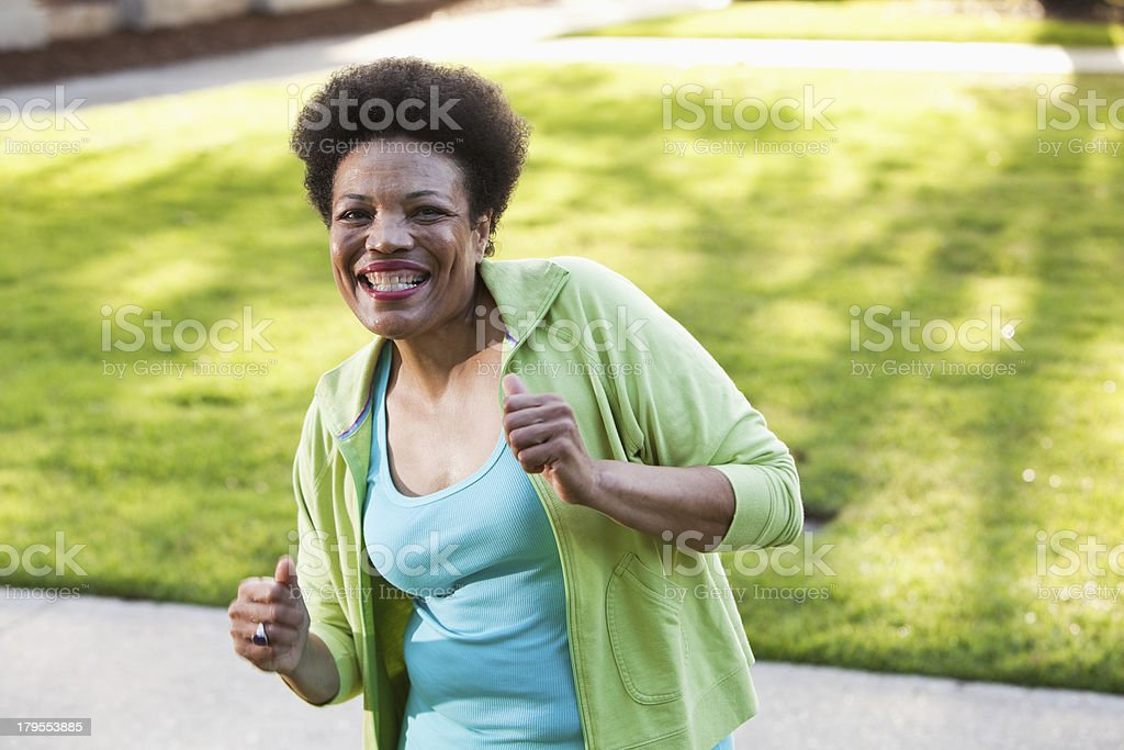 Cheerful woman in the park stock photo