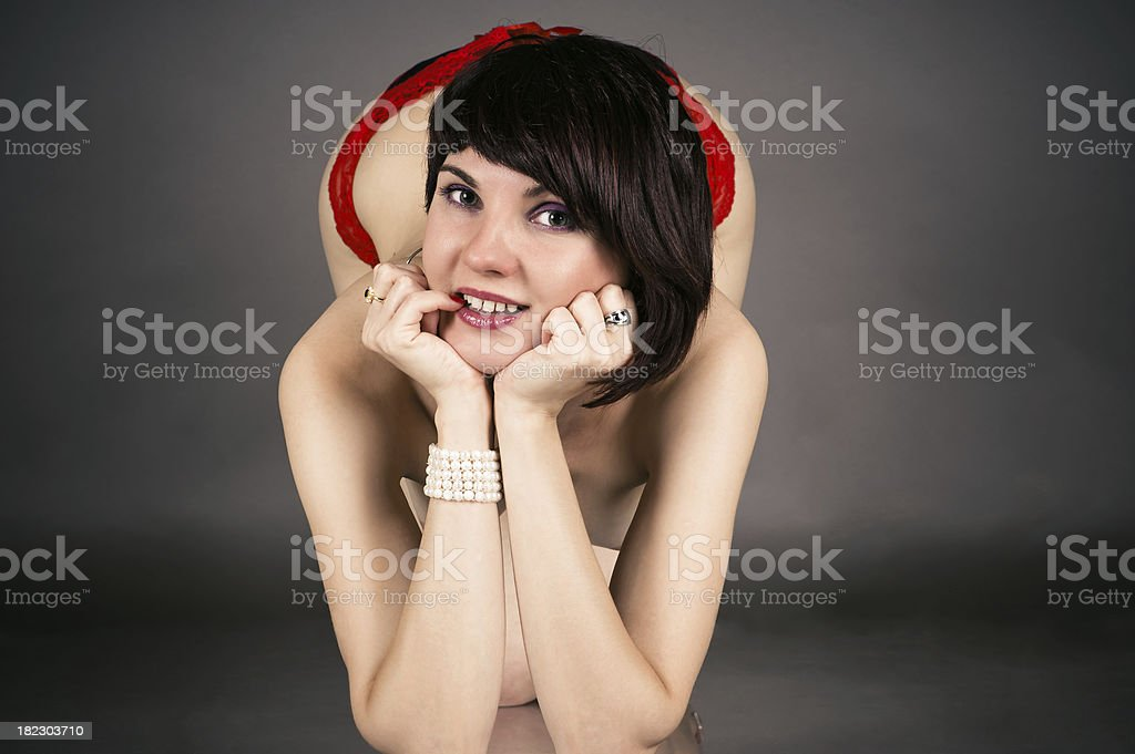 cheerful woman kneeling royalty-free stock photo