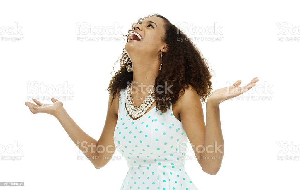 Cheerful woman looking up stock photo