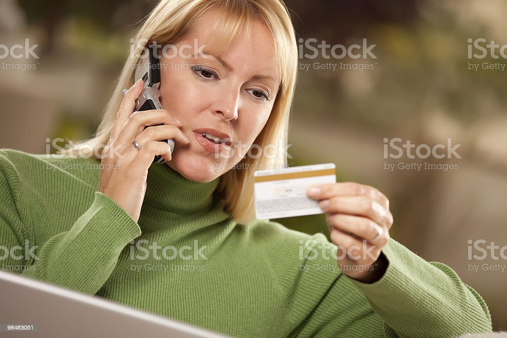 Cheerful Woman on Phone and Laptop with Credit Card royalty-free stock photo