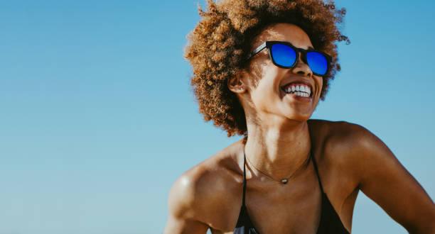 Cheerful woman on summer vacation stock photo