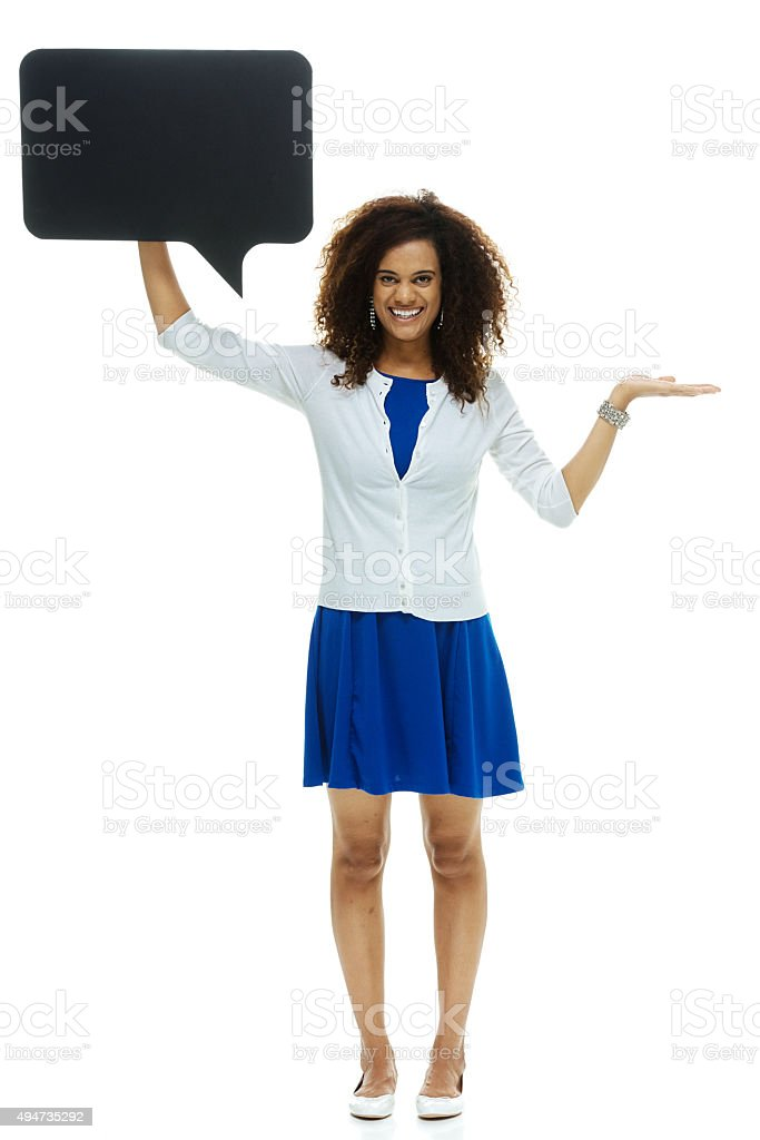 Cheerful woman presenting with speech bubble stock photo