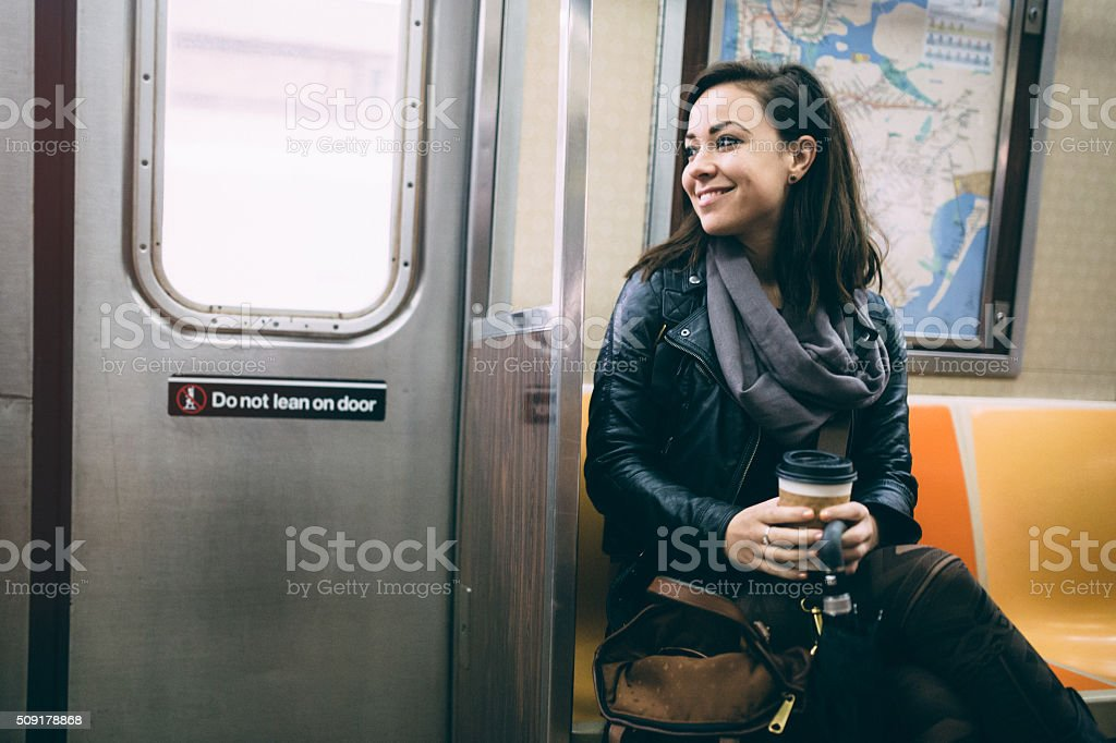 Cheerful Woman Riding Subway stock photo