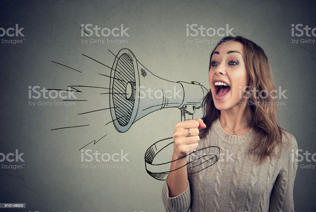 Cheerful woman sharing with news using loudspeaker royalty-free stock photo