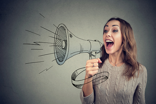Cheerful Woman Sharing With News Using Loudspeaker Stock Photo - Download Image Now