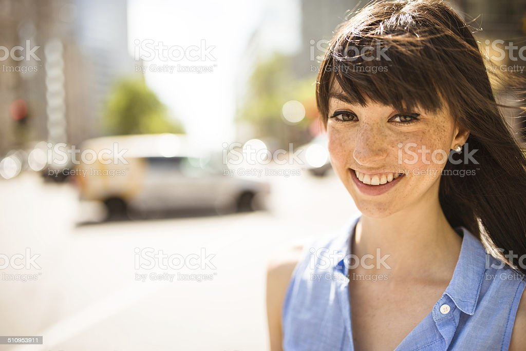 cheerful woman smiling on the city stock photo
