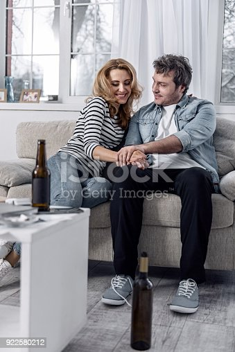 istock Cheerful woman smiling while sitting with her calm husband 922580212