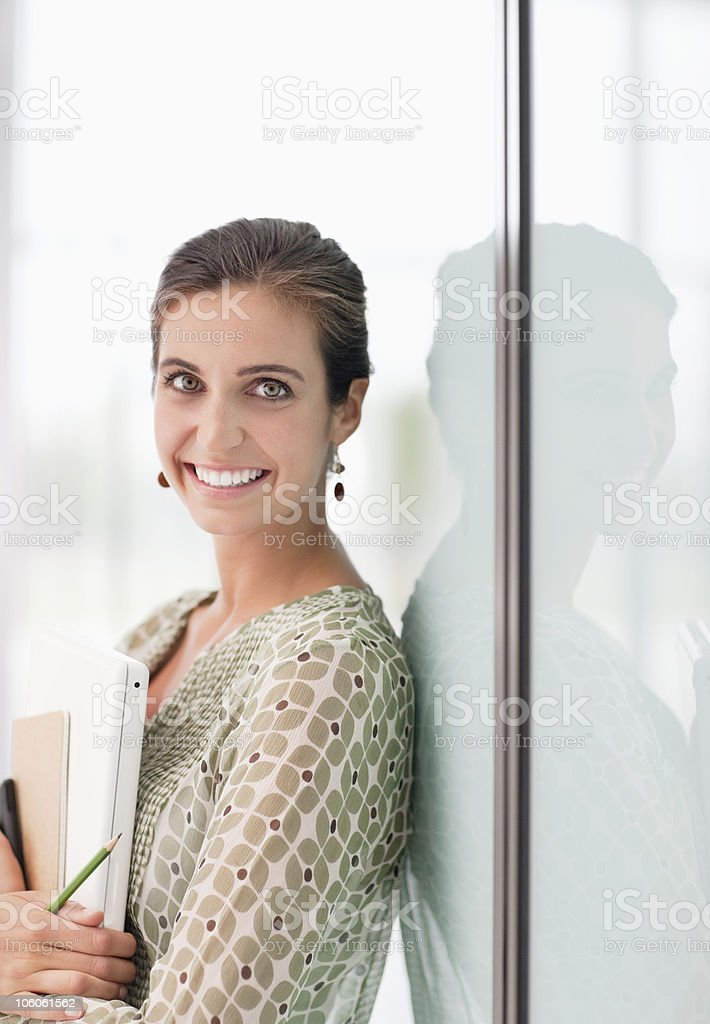 Cheerful woman standing with document and mobile phone royalty-free stock photo