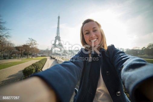 istock Cheerful woman takes selfie in Paris-Eiffel tower 533277257