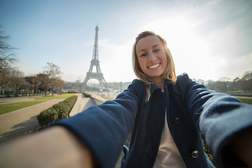 istock Cheerful woman takes selfie in Paris-Eiffel tower 533277257