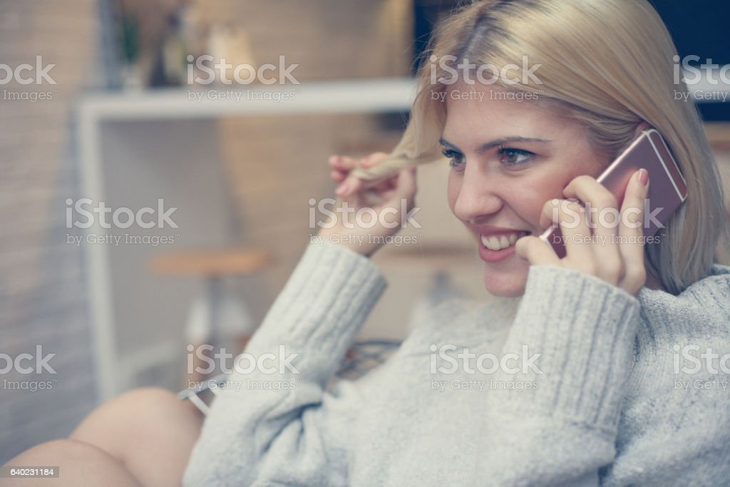 Cheerful woman talking on cell phone. stock photo